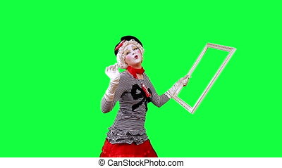 Framing Frame - Mime paints a picture. This clip is...