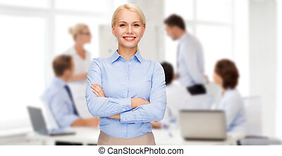 young smiling businesswoman with crossed arms - business and...