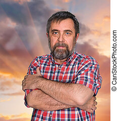 Middle-aged man on cloudy sky background - Middle-aged man...