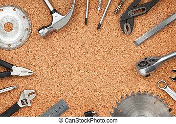 Set of tools on cork background - Set of tools on cork panel...