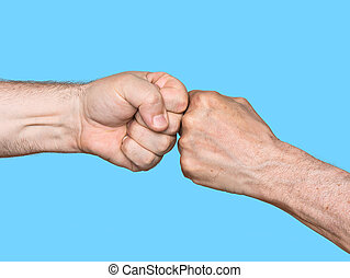 Two men bumping fists isolated on blue background
