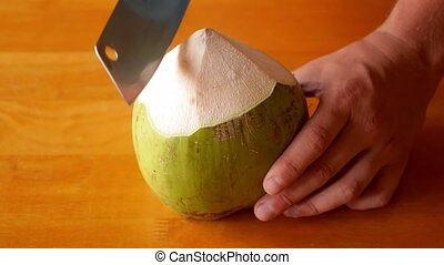 Chopping Green Coconut for Fresh Drink. Traditional Thailand Drink.