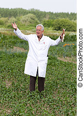 Satisfied agronomist - Satisfied old agronomist with spread...