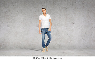 smiling young man in white t-shirt - happiness, advertising...