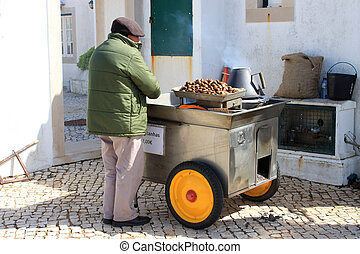 Roasting Chestnuts - CABO DA ROCA, PORTUGAL, APRIL 18, 2014:...