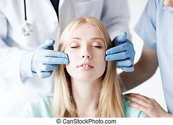 plastic surgeon and nurse with patient - healthcare, medical...