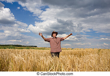 Happy man in wheat field - Old peasant standing with open...