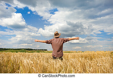 Peasant's satisfaction - Old peasant standing with open arms...