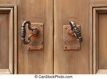 old double door knocker - close-up of old double door...