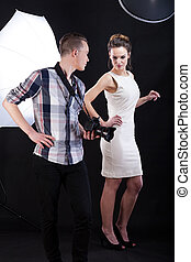 Photographer giving advice to female model during photo...