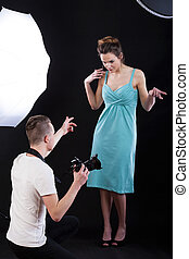 Backstage of photo shooting at professional studio, vertical