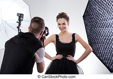 Photographer and model working together - Fashion...