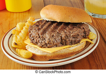 Home cooked cheeseburger - A home cooked cheeseburger on a...