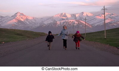 Children Running on the Road - Three children running a race...