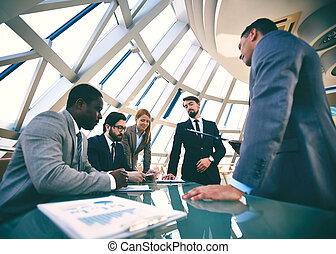 Brainstorming - Group of business people discussing...