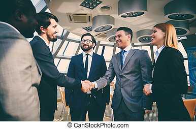 Striking deal - Group of business people looking at their...