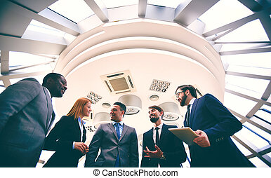 Negotiations - Group of business people discussing ideas and...