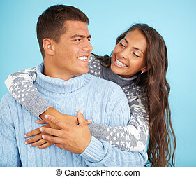 Affection - Portrait of happy girl embracing her boyfriend