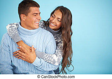 Amorous couple - Portrait of happy girl embracing her...