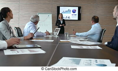 Giving Presentation - Zoom-in of business lady reporting at...