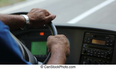 bus driver - arms of bus driver turns the steering wheel...