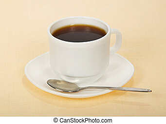 Coffee in cup with saucer