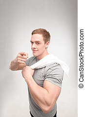 Man after workout with towel - Waist up portrait of a...