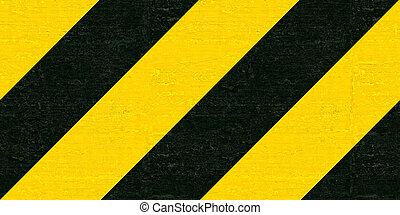 Warning black and yellow hazard stripes texture....