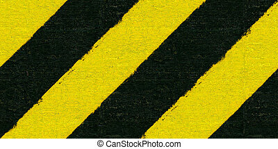 Warning black and yellow hazard stripes texture Construction...
