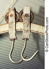 Two metal hooks in a factory