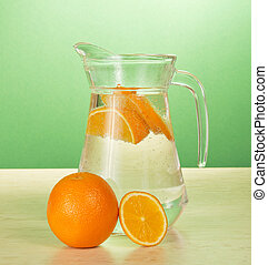 Jug with drink and oranges - Jug with cold drink and oranges...