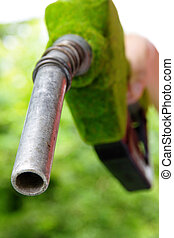 green fuel nozzle, - Fill up the gas tank,energy concept