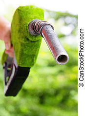 green fuel nozzle - Fill up the gas tank,energy concept