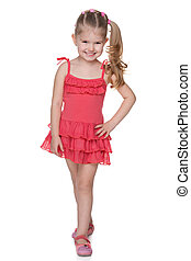 Little girl in the red dress - A smiling little girl in the...