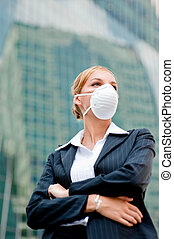 Businesswoman Wearing Mask - A young businesswoman wearing a...