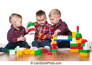 Little boys are playing with blocks