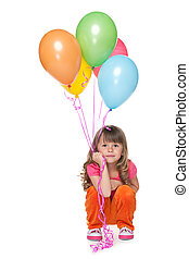 Thoughtful little girl with balloons
