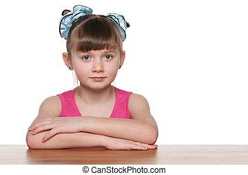 Pretty schoolgirl at the desk