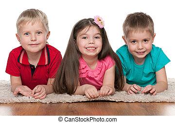 Smiling children on the white carpet