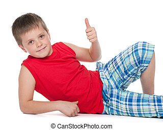 Young boy on the floor holds his thumb up
