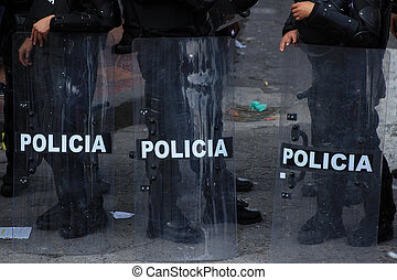 Police Riot Shields - Police officers with shields and...