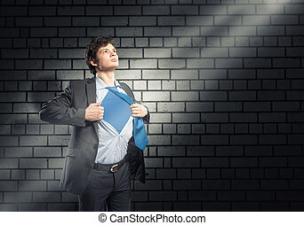 super hero - businessman tearing his shirt under her blue...