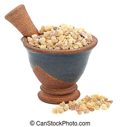 Frankincense in a mortar with pestle over white background.
