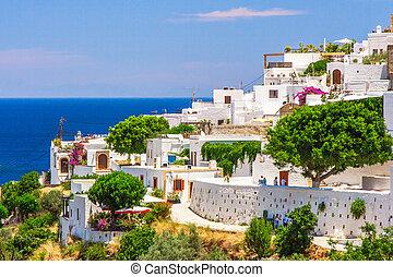Mediterranean village with white houses on the sea - white...