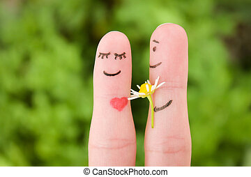 Happy couple Man is giving flowers to a woman Finger smileys...