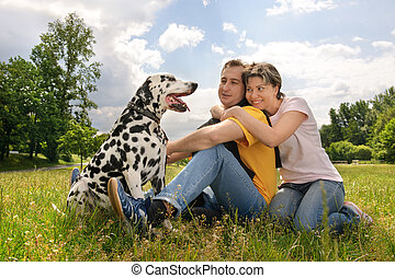 couple with a dog - loving couple with a Dalmatian outdoors