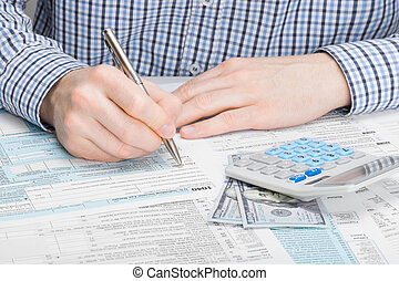 Male filling out 1040 US Tax Form