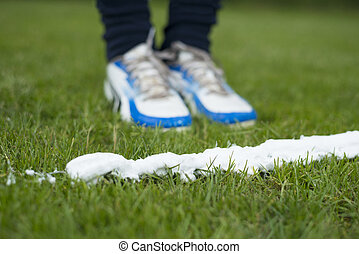 Vanishing foam spray line - Soccer player standing at foam...