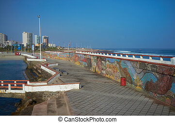 Colourful Seawall - Colourfully decorated murals adorning a...