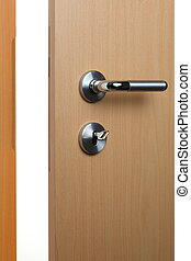 door knob - an open door with key and door knob